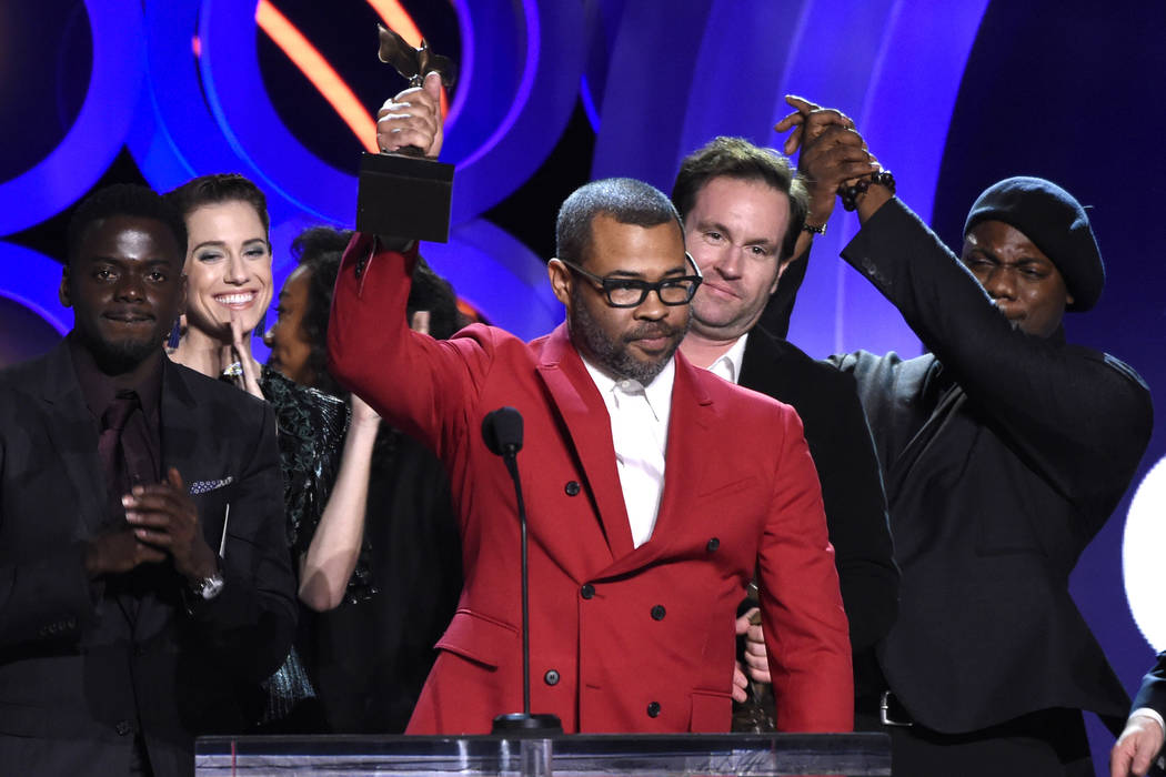 """Jordan Peele accepts the award for best feature for """"Get Out"""" at the 33rd Film Independent Spirit Awards on Saturday, March 3, 2018, in Santa Monica, Calif. (Photo by Chris Pizzello/Invi ..."""