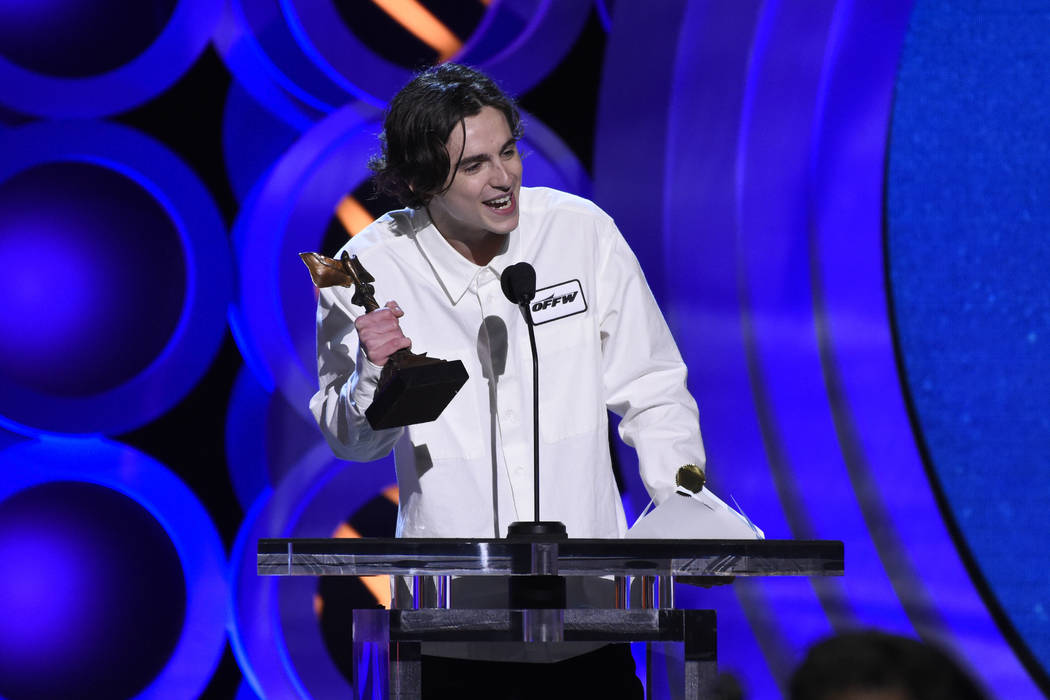 """Timothee Chalamet accepts the award for best male lead for """"Call Me by Your Name"""" at the 33rd Film Independent Spirit Awards on Saturday, March 3, 2018, in Santa Monica, Calif. (Photo by ..."""