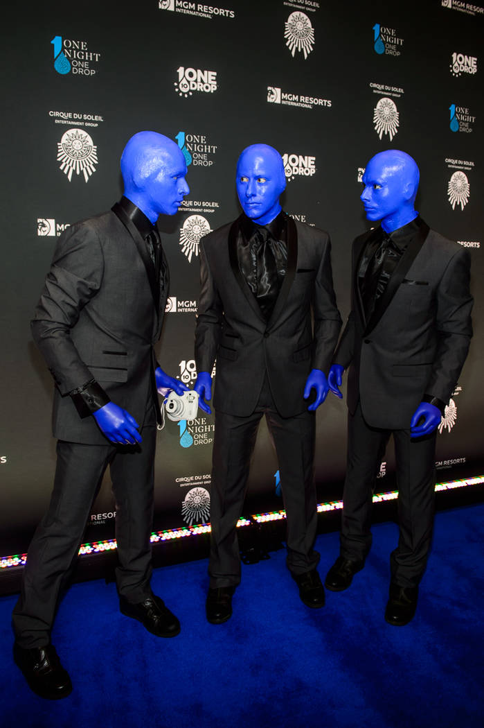 "Members of Blue Man Group are shown at ""One Night For One Drop"" on Friday, March 2, 2018. (Brenton Ho)"