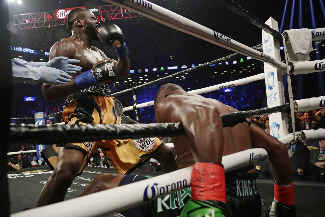 Deontay Wilder celebrates after knocking down Luis Ortiz during the sixth round of a WBC heavyweight championship boxing bout Saturday, March 3, 2018, in New York. Wilder stopped Ortiz in the 10th ...