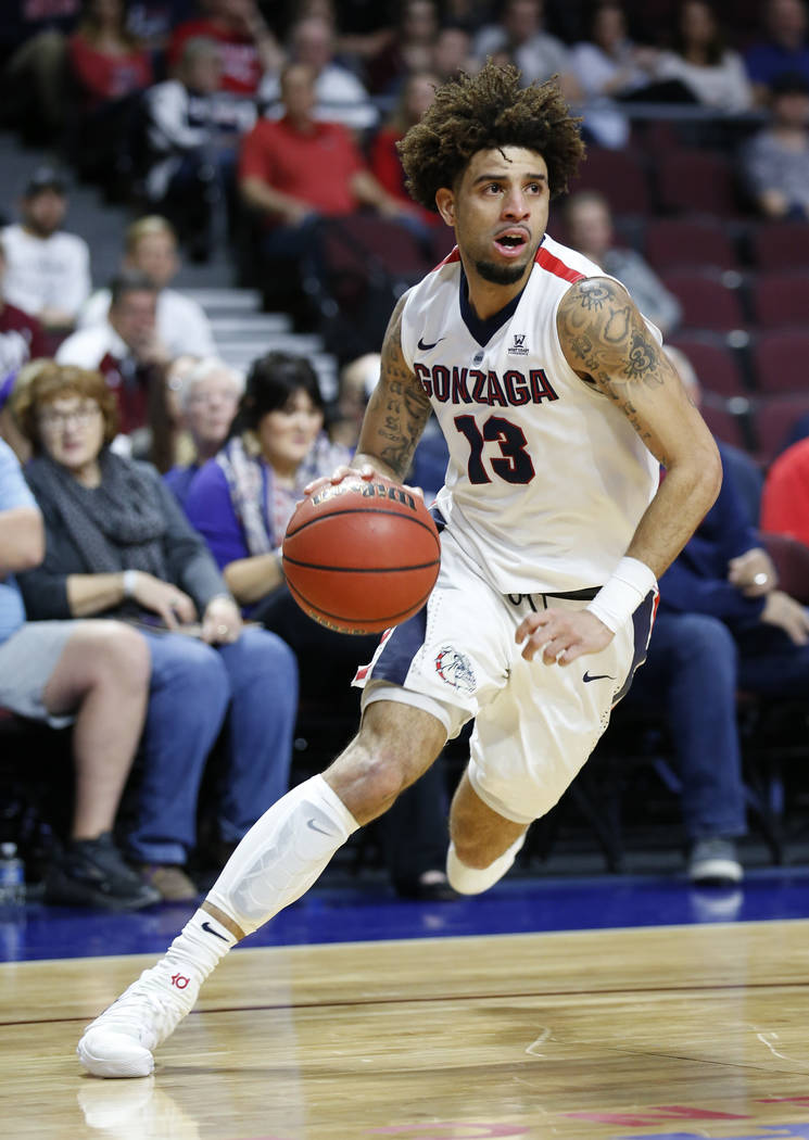Gonzaga Bulldogs guard Josh Perkins (13) drives the ball against the Loyola Marymount Lions during the West Coast Conference Basketball Tournament quarterfinals at the Orleans Arena  in Las Vegas  ...