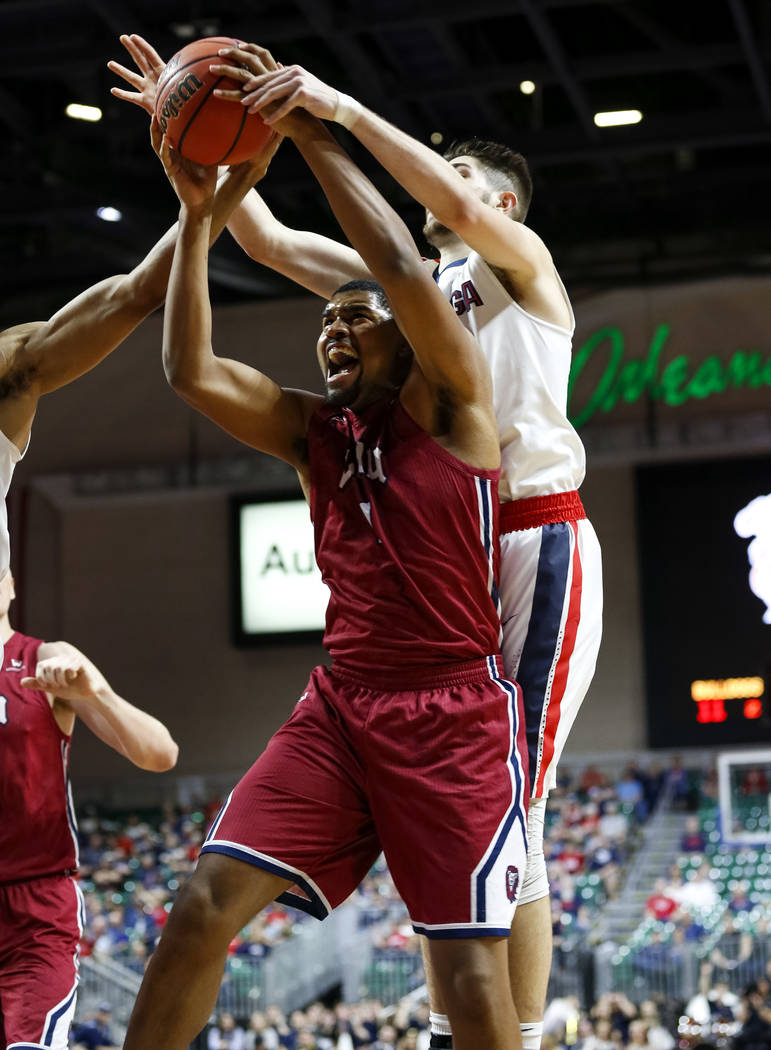 Loyola Marymount Lions forward Zafir Williams (1) takes the rebound from Gonzaga Bulldogs forward Killian Tillie (33) during the West Coast Conference Basketball Tournament quarterfinals at the Or ...