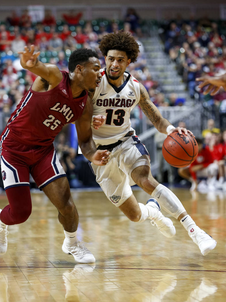 Gonzaga Bulldogs guard Josh Perkins (13) drives the ball against Loyola Marymount Lions guard Jeffery McClendon (25) during the West Coast Conference Basketball Tournament quarterfinals at the Orl ...