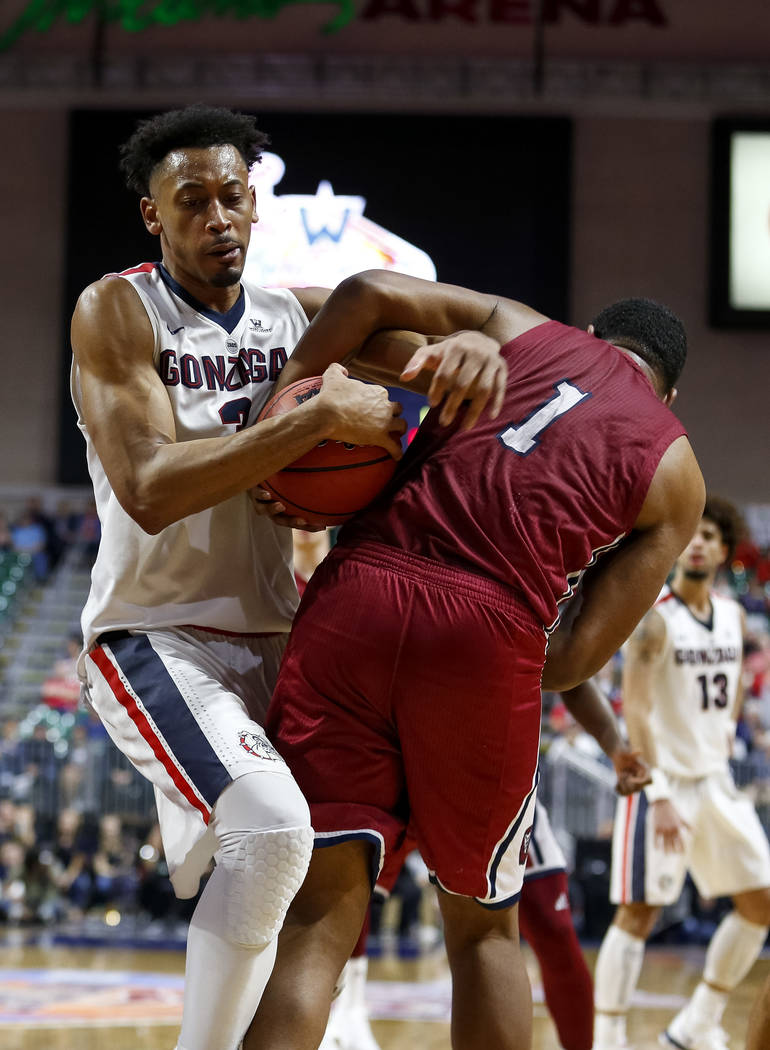 Gonzaga Bulldogs forward Johnathan Williams (3) and Loyola Marymount Lions forward Zafir Williams (1) fight for the ball during the West Coast Conference Basketball Tournament quarterfinals at the ...