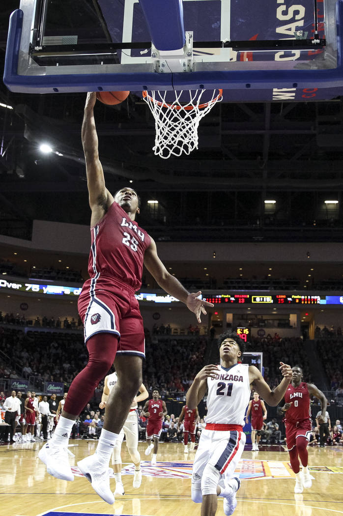 Loyola Marymount Lions guard Jeffery McClendon (25) goes for a layup against the Gonzaga Bulldogs during the West Coast Conference Basketball Tournament quarterfinals at the Orleans Arena  in Las  ...