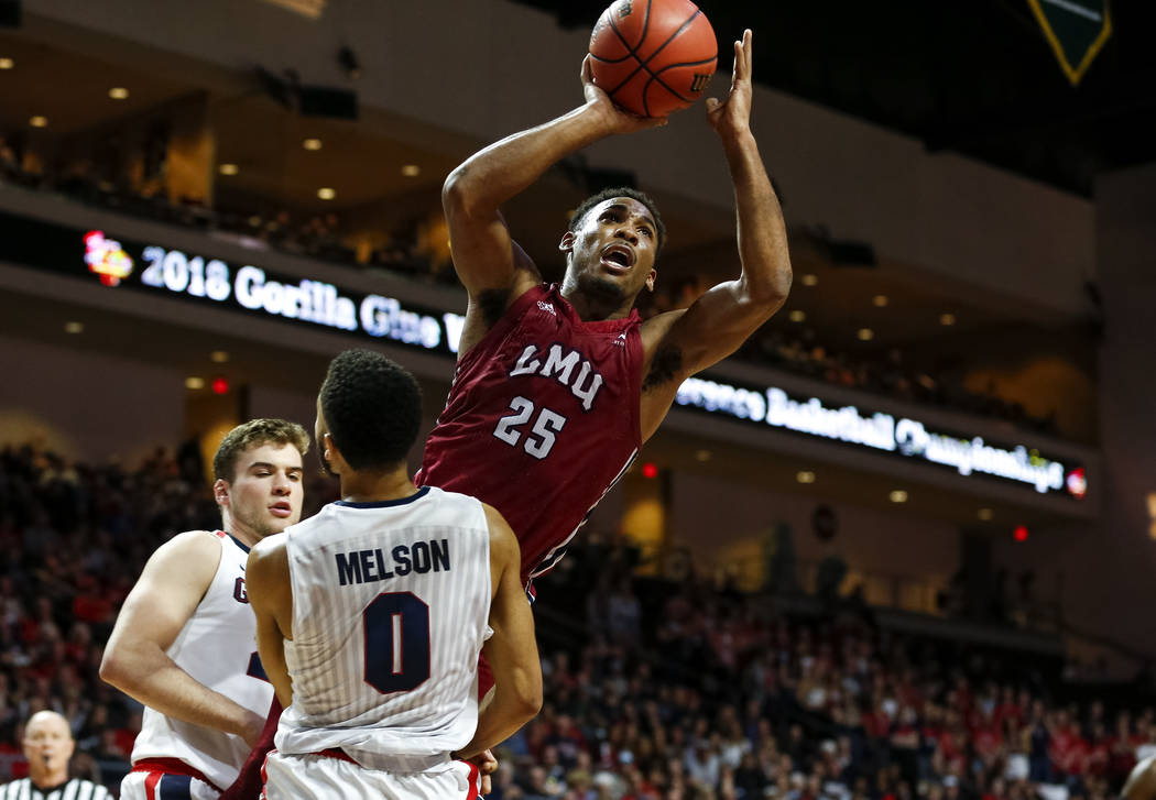 Loyola Marymount Lions guard Jeffery McClendon (25) attempts a shot over Gonzaga Bulldogs guard Silas Melson (0) during the West Coast Conference Basketball Tournament quarterfinals at the Orleans ...