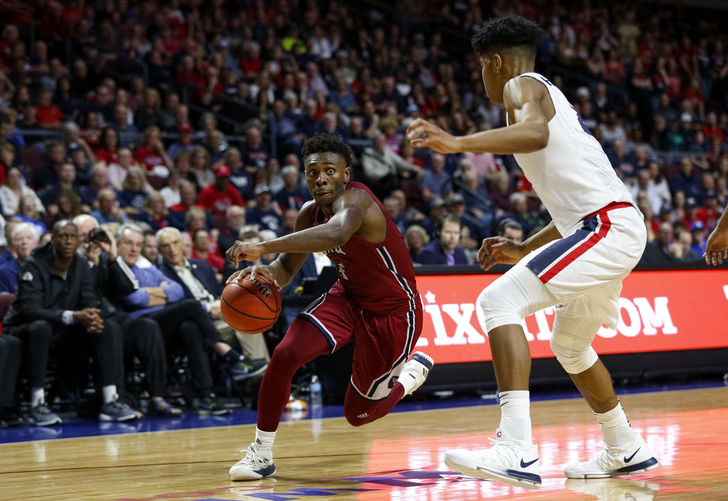 Loyola Marymount Lions guard James Batemon (5) dribbles the ball as Gonzaga Bulldogs forward Rui Hachimura (21) defends during the West Coast Conference Basketball Tournament quarterfinals at the  ...