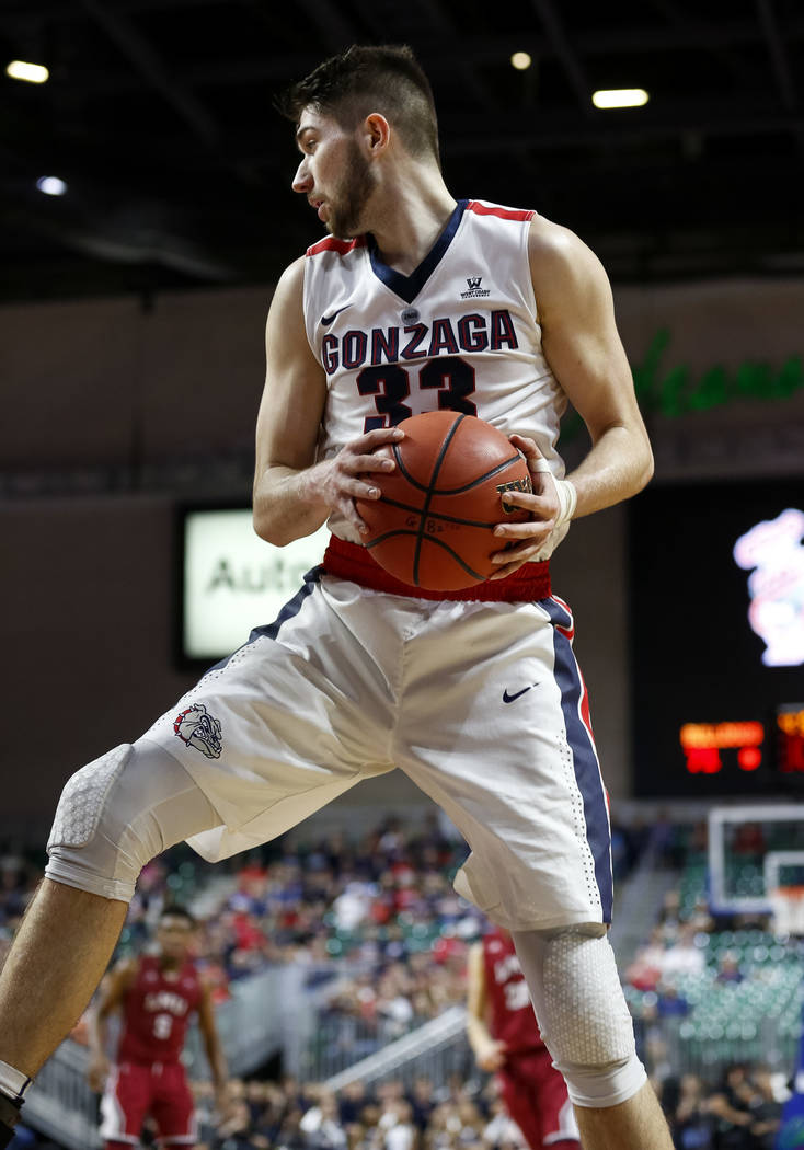 Gonzaga Bulldogs forward Killian Tillie (33) pulls in the rebound against the Loyola Marymount Lions during the West Coast Conference Basketball Tournament quarterfinals at the Orleans Arena  in L ...