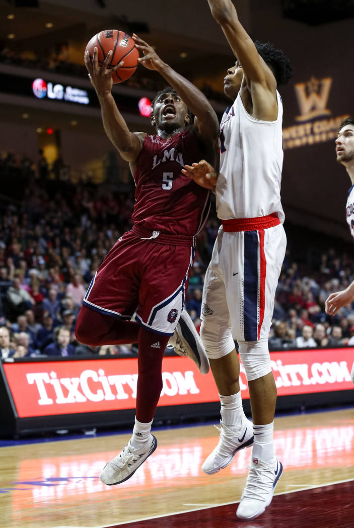 Loyola Marymount Lions guard James Batemon (5) goes up for a shot as Gonzaga Bulldogs forward Rui Hachimura (21) defends during the West Coast Conference Basketball Tournament quarterfinals at the ...