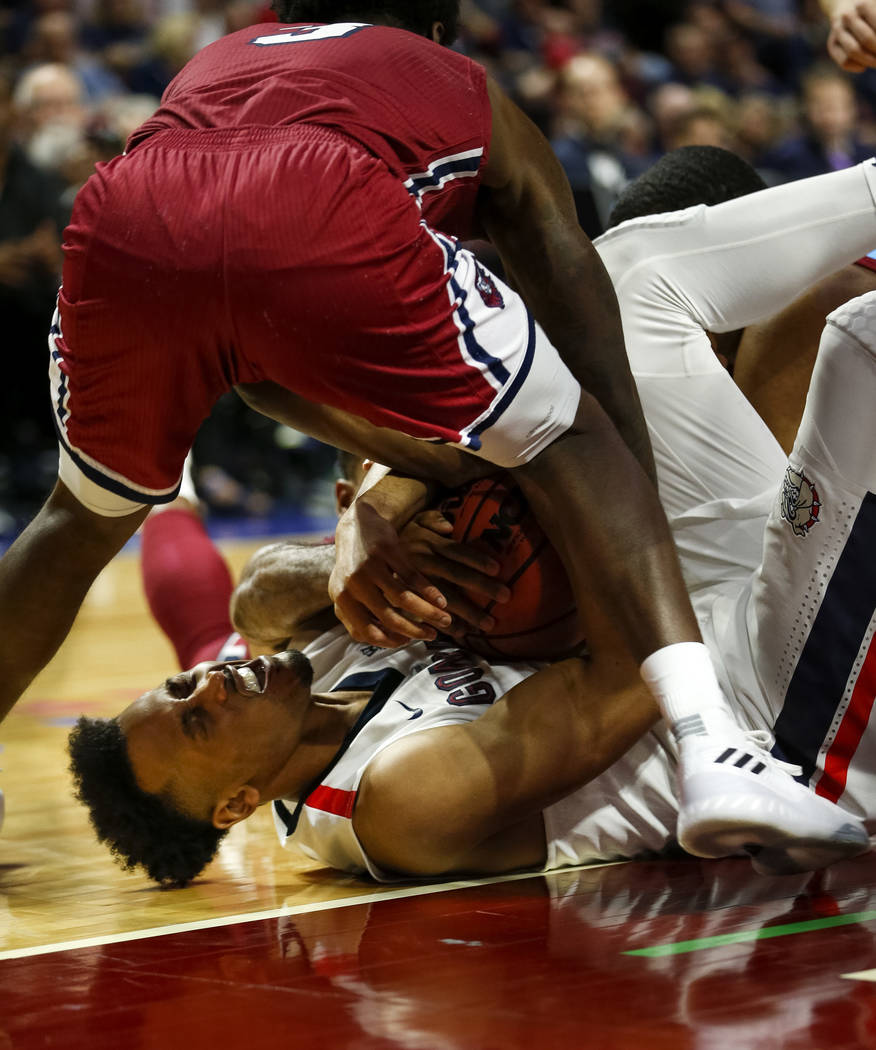 Loyola Marymount Lions guard Cameron Allen (3) and Gonzaga Bulldogs forward Johnathan Williams (3) fight for the ball during the West Coast Conference Basketball Tournament quarterfinals at the Or ...
