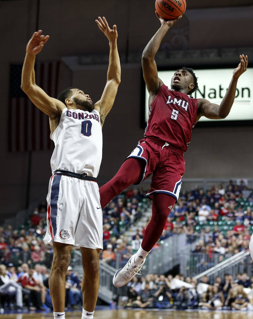 Loyola Marymount Lions guard James Batemon (5) shoots over Gonzaga Bulldogs guard Silas Melson (0) during the West Coast Conference Basketball Tournament quarterfinals at the Orleans Arena  in Las ...