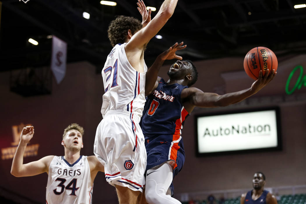 Pepperdine Waves guard Amadi Udenyi (0) attempts a shot over St. Mary's Gaels center Evan Fitzner (21) during the West Coast Conference Basketball Tournament quarterfinals at the Orleans Arena  in ...