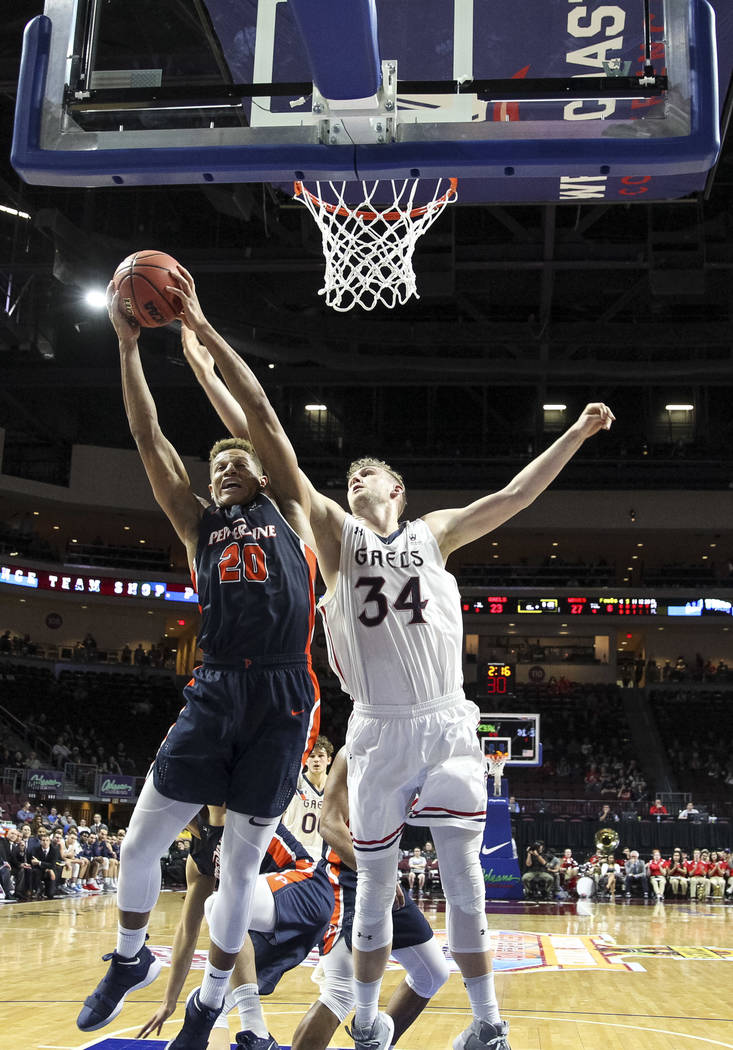 Pepperdine Waves forward Kameron Edwards (20) pulls in the rebound over St. Mary's Gaels center Jock Landale (34) during the West Coast Conference Basketball Tournament quarterfinals at the Orlean ...