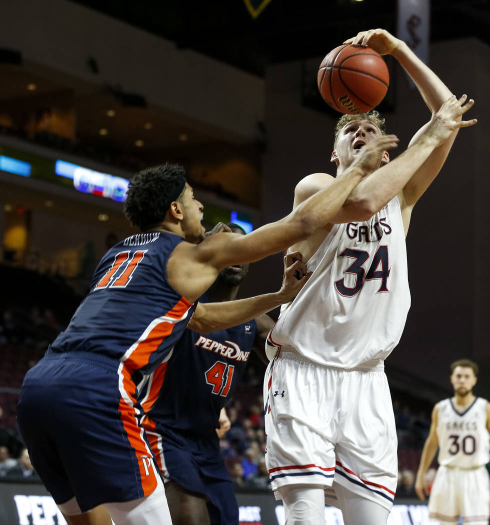 Pepperdine Waves guard Trae Berhow (11) blocks an attempt from St. Mary's Gaels center Jock Landale (34) during the West Coast Conference Basketball Tournament quarterfinals at the Orleans Arena i ...