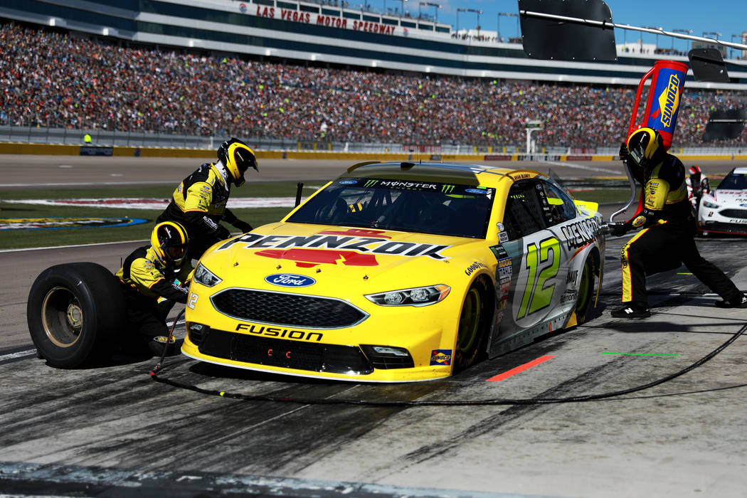Ryan Blaney's (12) pit crew work on his vehicle during the Monster Energy NASCAR Cup Series Pennzoil 400 auto race at the Las Vegas Motor Speedway in Las Vegas on Sunday, March 4, 2018. Andrea Cor ...