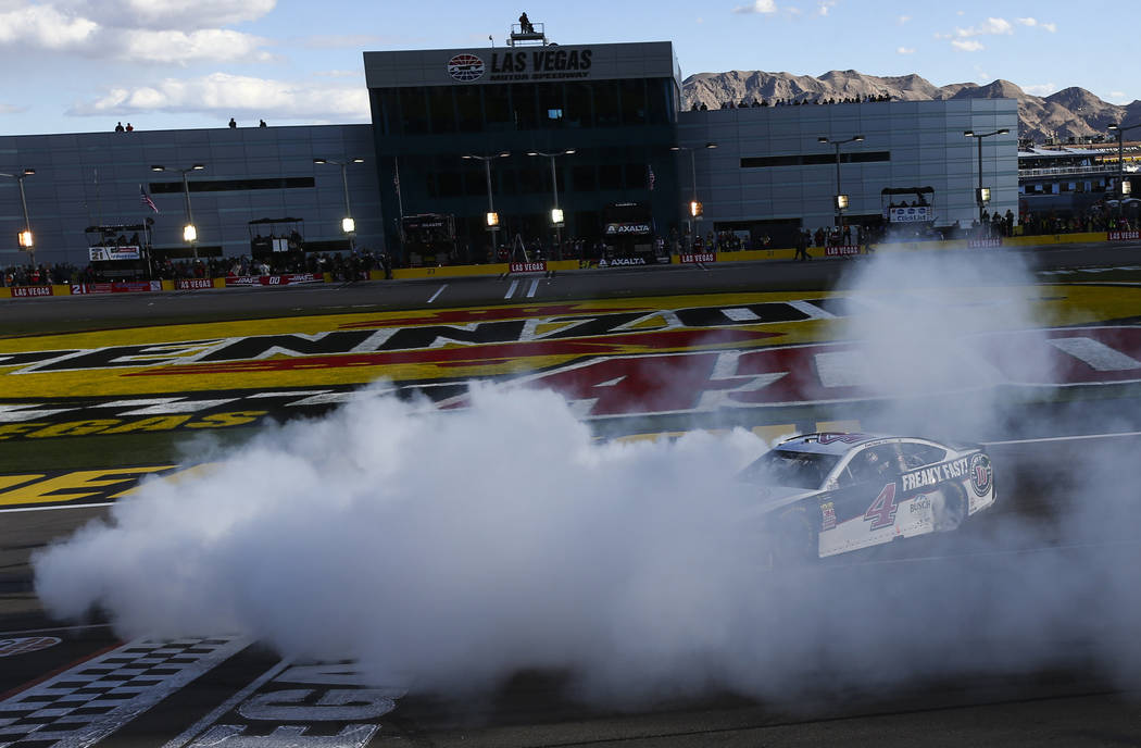 Kevin Harvick (4) does a burnout after winning the Monster Energy NASCAR Cup Series Pennzoil 400 auto race at the Las Vegas Motor Speedway in Las Vegas on Sunday, March 4, 2018. Chase Stevens Las  ...
