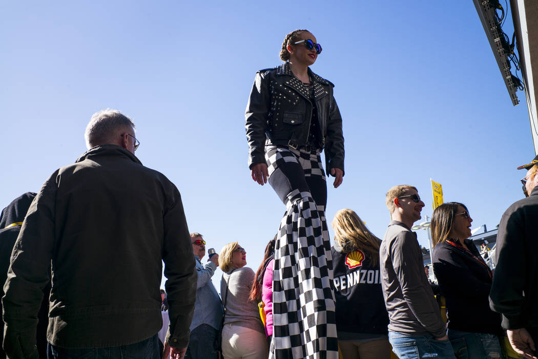 A woman walks on stilts before the Monster Energy NASCAR Cup Series Pennzoil 400 auto race at the Las Vegas Motor Speedway in Las Vegas on Sunday, March 4, 2018. Chase Stevens Las Vegas Review-Jou ...