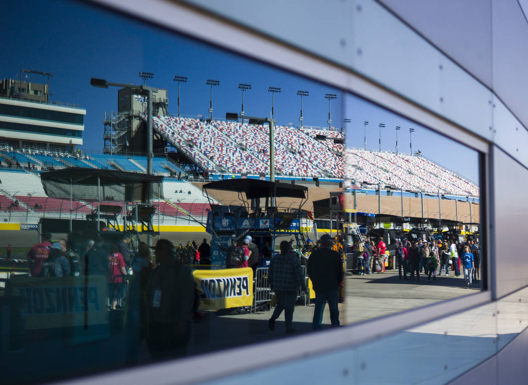 NASCAR fans check out pit road before the Monster Energy NASCAR Cup Series Pennzoil 400 auto race at the Las Vegas Motor Speedway in Las Vegas on Sunday, March 4, 2018. Chase Stevens Las Vegas Rev ...
