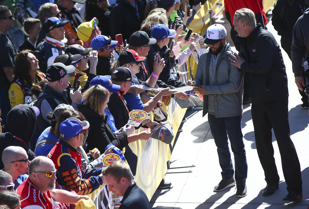 Driver Darrell Wallace Jr. (43) signs autographs before the Monster Energy NASCAR Cup Series Pennzoil 400 auto race at the Las Vegas Motor Speedway in Las Vegas on Sunday, March 4, 2018. Chase Ste ...