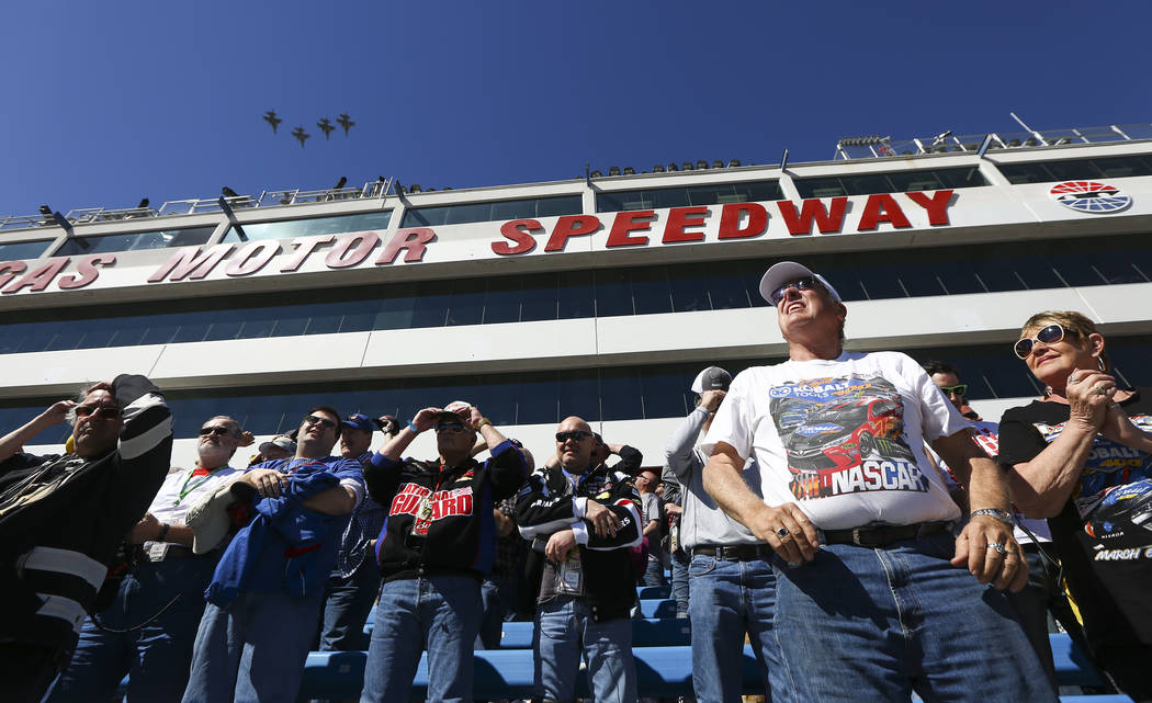 Race fans watch the F-16 flyover before the start of the Monster Energy NASCAR Cup Series Pennzoil 400 auto race at the Las Vegas Motor Speedway in Las Vegas on Sunday, March 4, 2018. Chase Steven ...