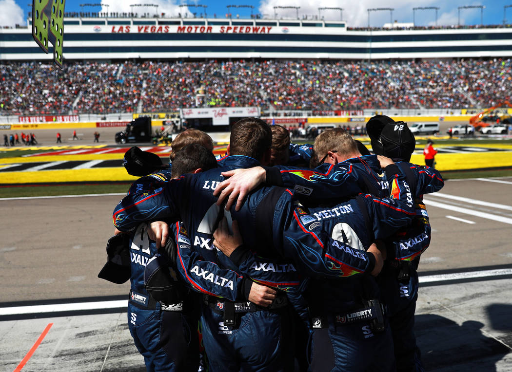 William Byron's (24) pit crew huddles together before the start of the Monster Energy NASCAR Cup Series Pennzoil 400 auto race at the Las Vegas Motor Speedway in Las Vegas on Sunday, March 4, 2018 ...