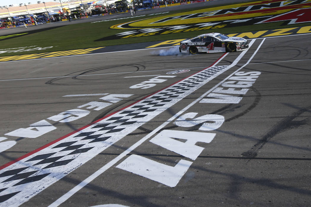 Kevin Harvick (4) crosses the finish line to win the Monster Energy NASCAR Cup Series Pennzoil 400 auto race at the Las Vegas Motor Speedway in Las Vegas on Sunday, March 4, 2018. Chase Stevens La ...