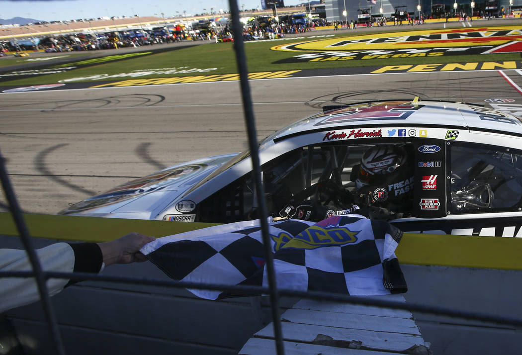 Kevin Harvick (4) gets the checkered flag after winning the Monster Energy NASCAR Cup Series Pennzoil 400 auto race at the Las Vegas Motor Speedway in Las Vegas on Sunday, March 4, 2018. Chase Ste ...