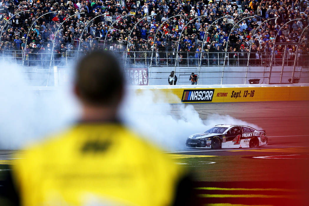 Kevin Harvick (4) does a burnout after winning the Monster Energy NASCAR Cup Series Pennzoil 400 auto race at the Las Vegas Motor Speedway in Las Vegas on Sunday, March 4, 2018. Andrea Cornejo Las ...