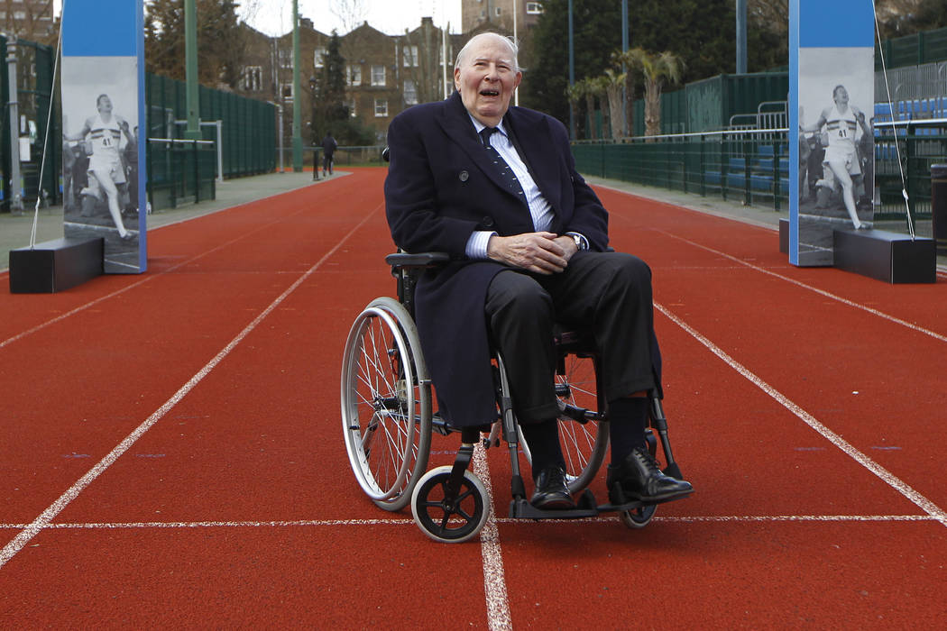 In this file photo dated Wednesday, Feb. 26, 2014, former British athlete Roger Bannister poses for a picture during the launch of the Westminster Mile run, to celebrate the 60th anniversary of Ba ...