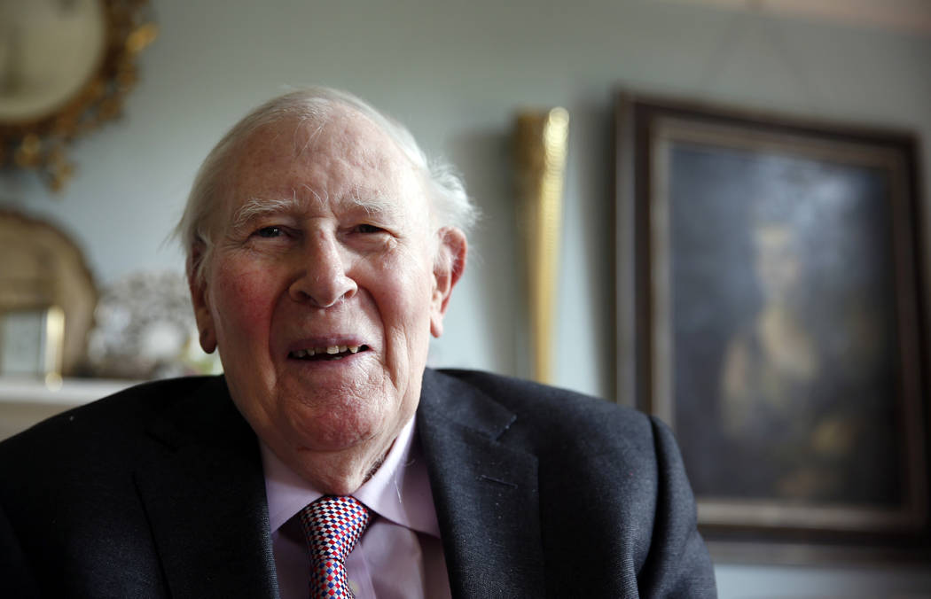 In this photo taken Monday, April 28, 2014, Roger Bannister, who as a young man was the first person to break the 4-minute barrier for the mile run in 1954, poses during an interview with The Asso ...