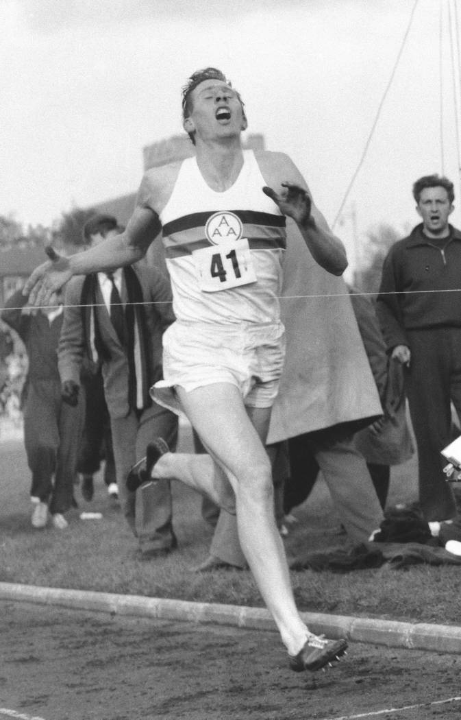 In this May 6, 1954 file photo, Britain's Roger Bannister hits the tape to break the four-minute mile in Oxford, England. A statement released Sunday March 4, 2018, on behalf of Bannister's family ...