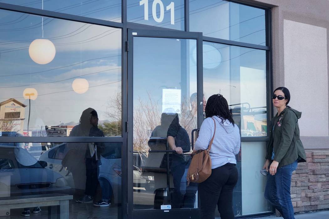 Sou Ngo apologizes to customers trying to enter the temporarily-closed Brew Tea Bar at 7380 S. Rainbow Blvd. on Monday, Feb. 26, 2017. Brew Tea Bar is undergoing a three-week renovation. (Rio Laca ...