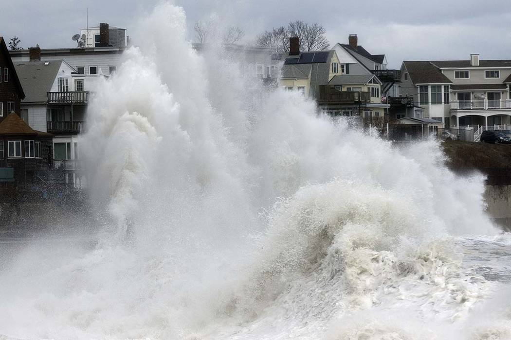 A large wave crashes into a seawall in Winthrop, Mass., Saturday, March 3, 2018, a day after a nor'easter pounded the Atlantic coast. Officials in eastern Massachusetts, where dozens of people wer ...