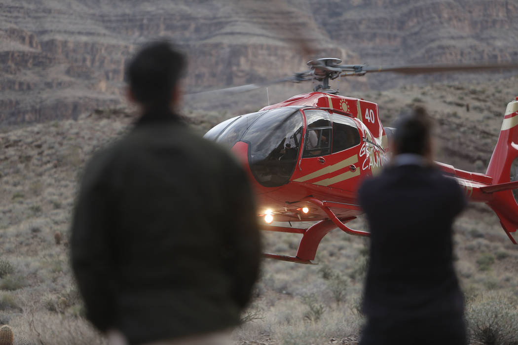Emergency personnel arrive at the scene of a deadly tour helicopter crash in the Grand Canyon, Arizona, Saturday, Feb. 10, 2018. The crash killed three people and injured four others.  Photo by Te ...