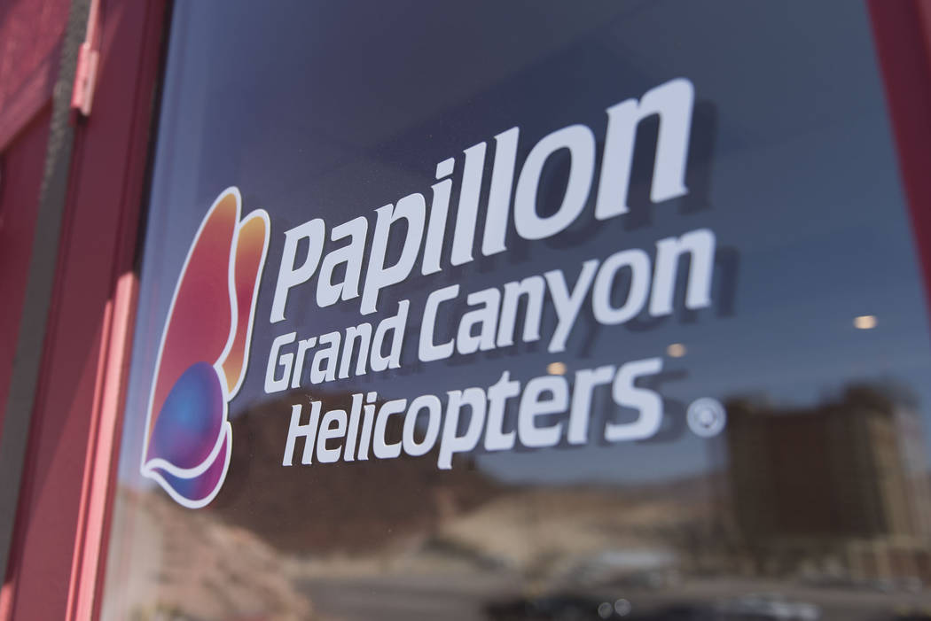 Signage for Papillon Grand Canyon Helicopters is seen on the entry of the new Hoover Dam helipad office in Boulder City, Thursday, Sept. 8, 2016. (Las Vegas Review-Journal)