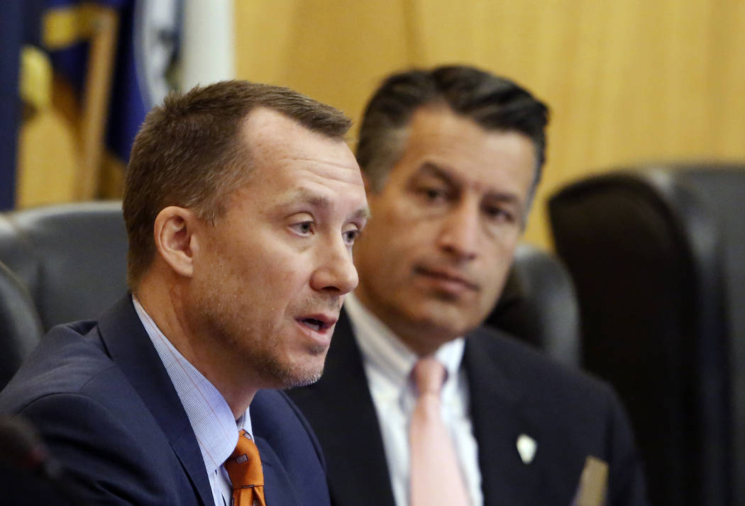Gaming Control Board Chairman, A.G. Burnett, left, speaks as Gov. Brian Sandoval, looks on as the Gaming Policy Committee discusses marijuana policy involving gaming establishments on Wednesday, N ...