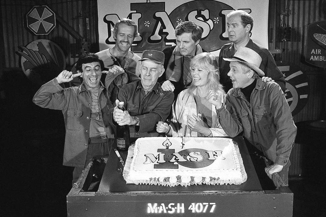 "In this Oct. 22, 1981, file photo, Jamie Farr, from front left, plugs his ears as cast members of the ""M.A.S.H."" television series cast Harry Morgan, Loretta Swit, William Christopher and, from ba ..."