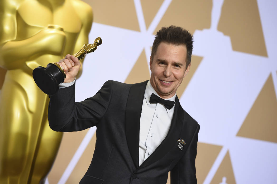 """Sam Rockwell, winner of the award for best performance by an actor in a supporting role for """"Three Billboards Outside Ebbing, Missouri"""", poses in the press room at the Oscars on Sunday,  ..."""