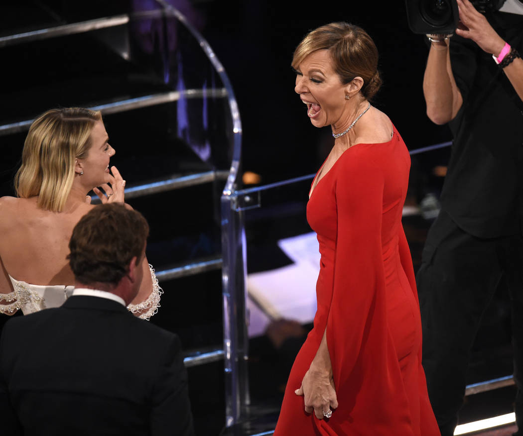 """Margot Robbie, left, reacts as Allison Janney wins the award for best performance by an actress in a supporting role for """"I, Tonya"""" at the Oscars on Sunday, March 4, 2018, at the Dolby T ..."""