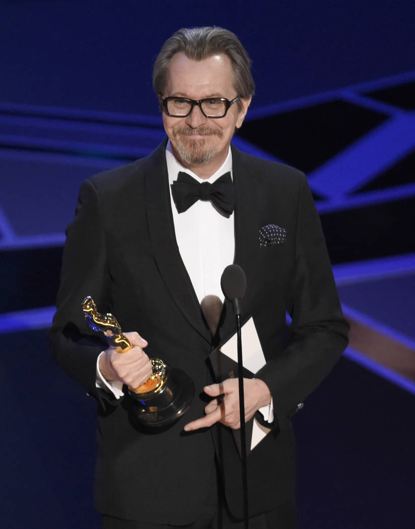 """Gary Oldman accepts the award for best performance by an actor in a leading role for """"Darkest Hour"""" at the Oscars on Sunday, March 4, 2018, at the Dolby Theatre in Los Angeles. (Photo by ..."""