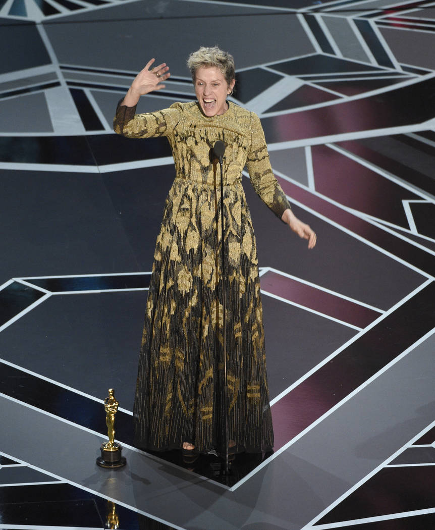 """Frances McDormand accepts the award for best performance by an actress in a leading role for """"Three Billboards Outside Ebbing, Missouri"""" at the Oscars on Sunday, March 4, 2018, at the Do ..."""