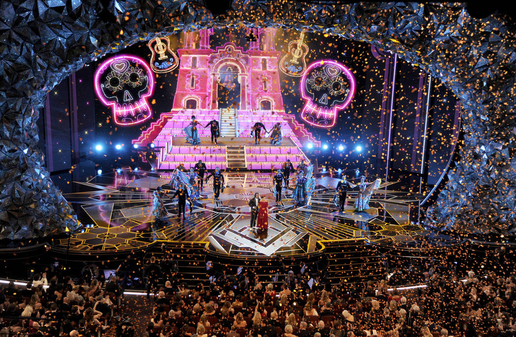 """Miguel Lafourcade, left, and Natalia Lafourcade perform """"Remember Me"""" from """"Coco"""" at the Oscars on Sunday, March 4, 2018, at the Dolby Theatre in Los Angeles. (Photo by Chris P ..."""