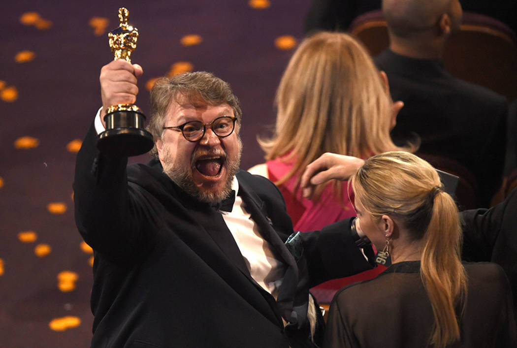 """Guillermo del Toro, winner of the award for best director for """"The Shape of Water"""" celebrates in the audience at the Oscars on Sunday, March 4, 2018, at the Dolby Theatre in Los Angeles. ..."""