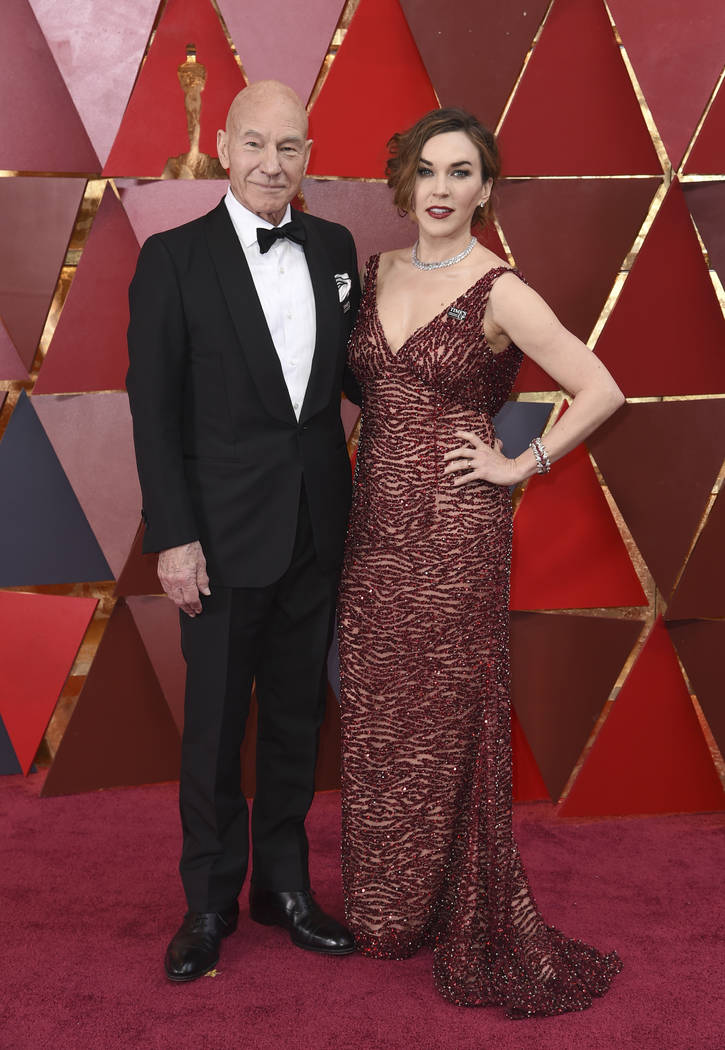 Patrick Stewart, left, and Sunny Ozell arrive at the Oscars on Sunday, March 4, 2018, at the Dolby Theatre in Los Angeles. (Photo by Richard Shotwell/Invision/AP)