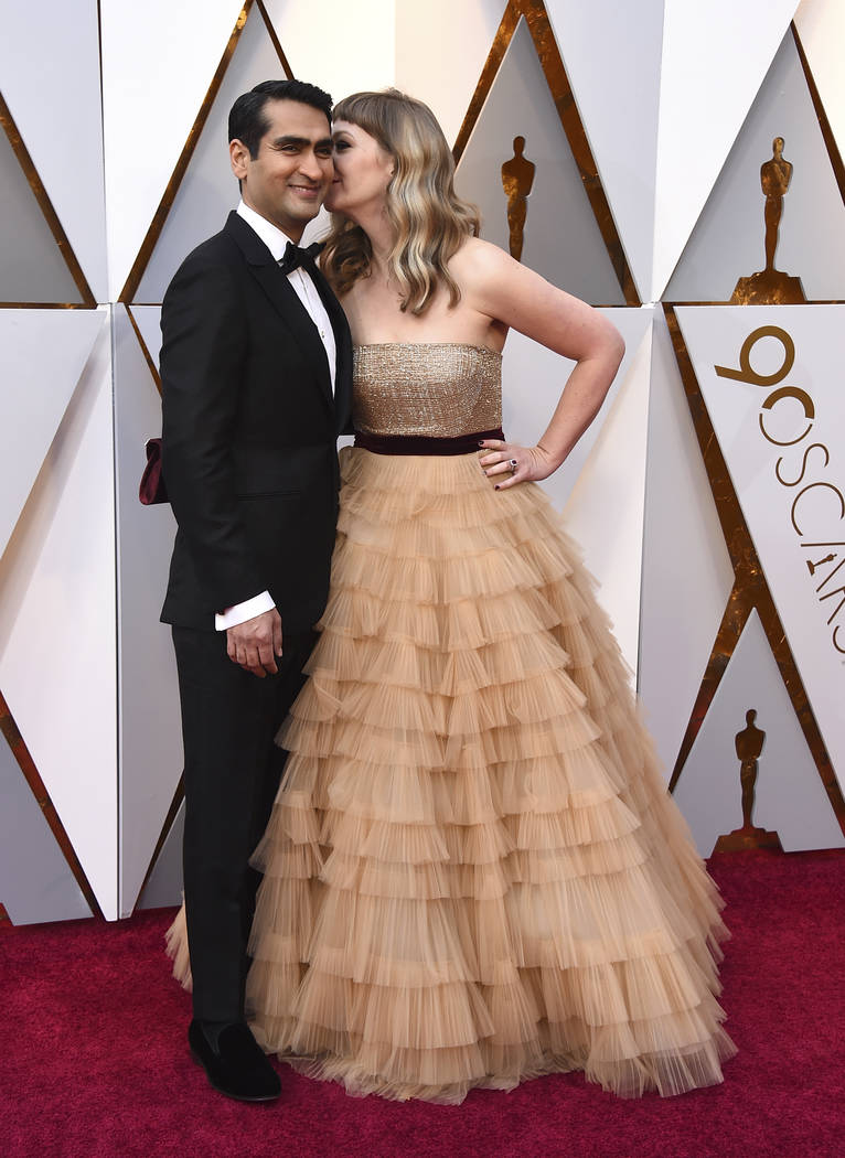 Kumail Nanjiani, left, and Emily V. Gordon arrive at the Oscars on Sunday, March 4, 2018, at the Dolby Theatre in Los Angeles. (Photo by Jordan Strauss/Invision/AP)