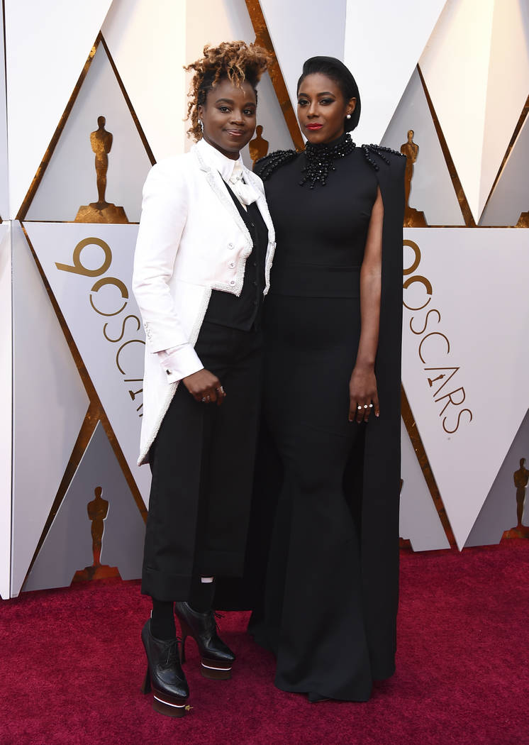 Dee Rees, left, and Sarah M. Broom arrive at the Oscars on Sunday, March 4, 2018, at the Dolby Theatre in Los Angeles. (Photo by Jordan Strauss/Invision/AP)