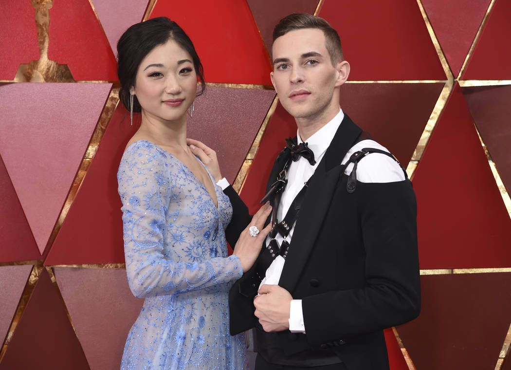 Mirai Nagasu, left, and Adam Rippon arrive at the Oscars on Sunday, March 4, 2018, at the Dolby Theatre in Los Angeles. (Photo by Richard Shotwell/Invision/AP)