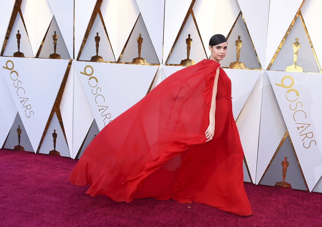Sofia Carson arrives at the Oscars on Sunday, March 4, 2018, at the Dolby Theatre in Los Angeles. (Photo by Jordan Strauss/Invision/AP)
