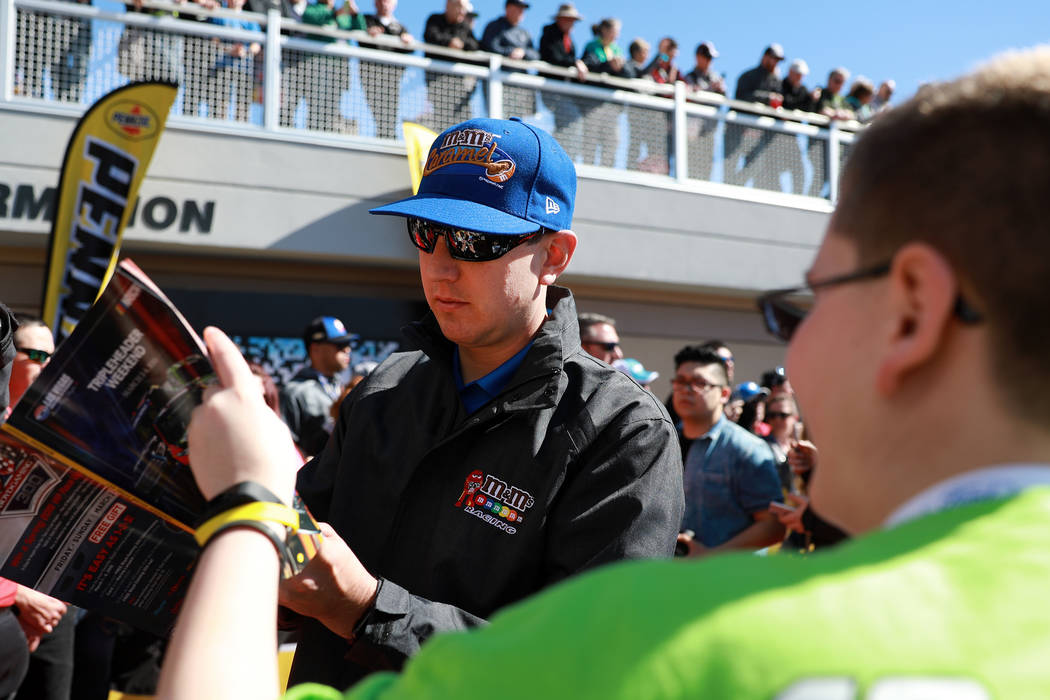 Kyle Busch signs autographs ahead of the Monster Energy NASCAR Cup Series Pennzoil 400 auto race at the Las Vegas Motor Speedway in Las Vegas on Sunday, March 4, 2018. Andrea Cornejo Las Vegas Rev ...