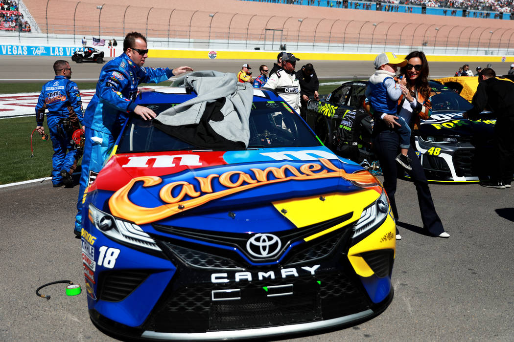 Samantha Busch and her son, Brexton, by Kyle Busch's car ahead of the Monster Energy NASCAR Cup Series Pennzoil 400 auto race at the Las Vegas Motor Speedway in Las Vegas on Sunday, March 4, 2018. ...